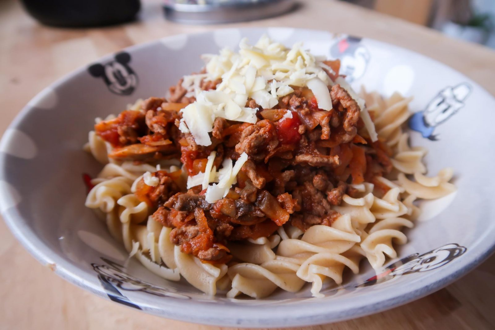 bolognese recipe served with pasta and cheese